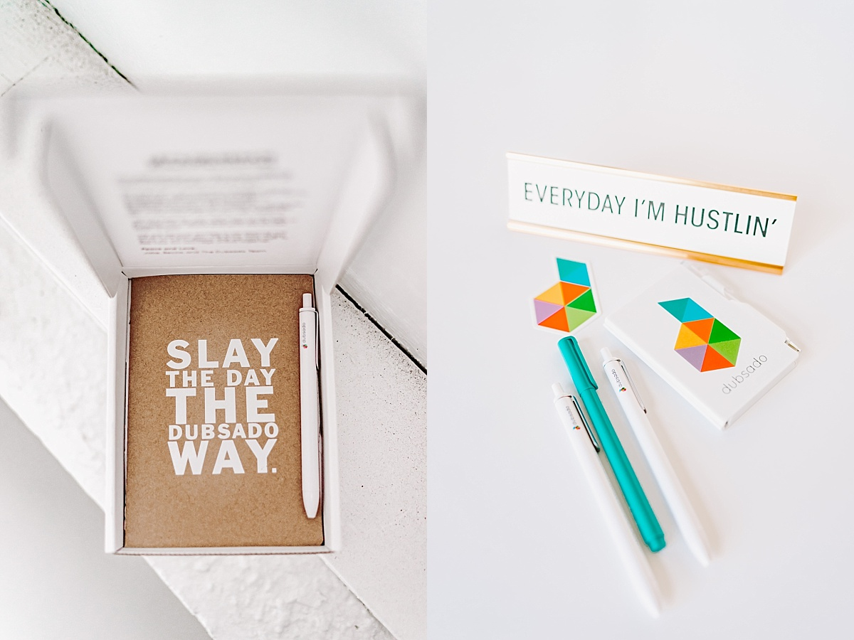 A Dubsado branded cork journal with the words 'slay the day the dubsado way' on the front