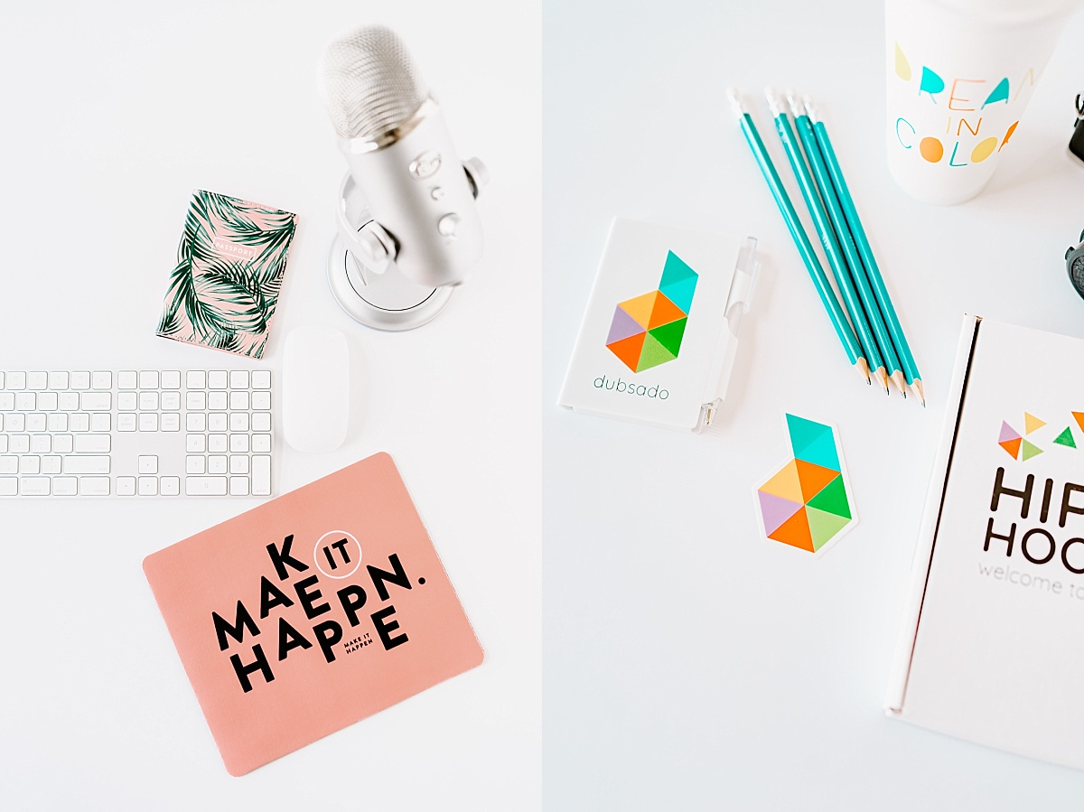 Dubsado branded flat lay marketing image of a microphone, keyboard, journal, and mousepad that says 'make it happen'