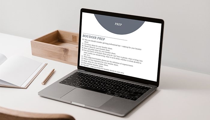 a laptop sitting on a desk open to a document that says boudoir blog prompts