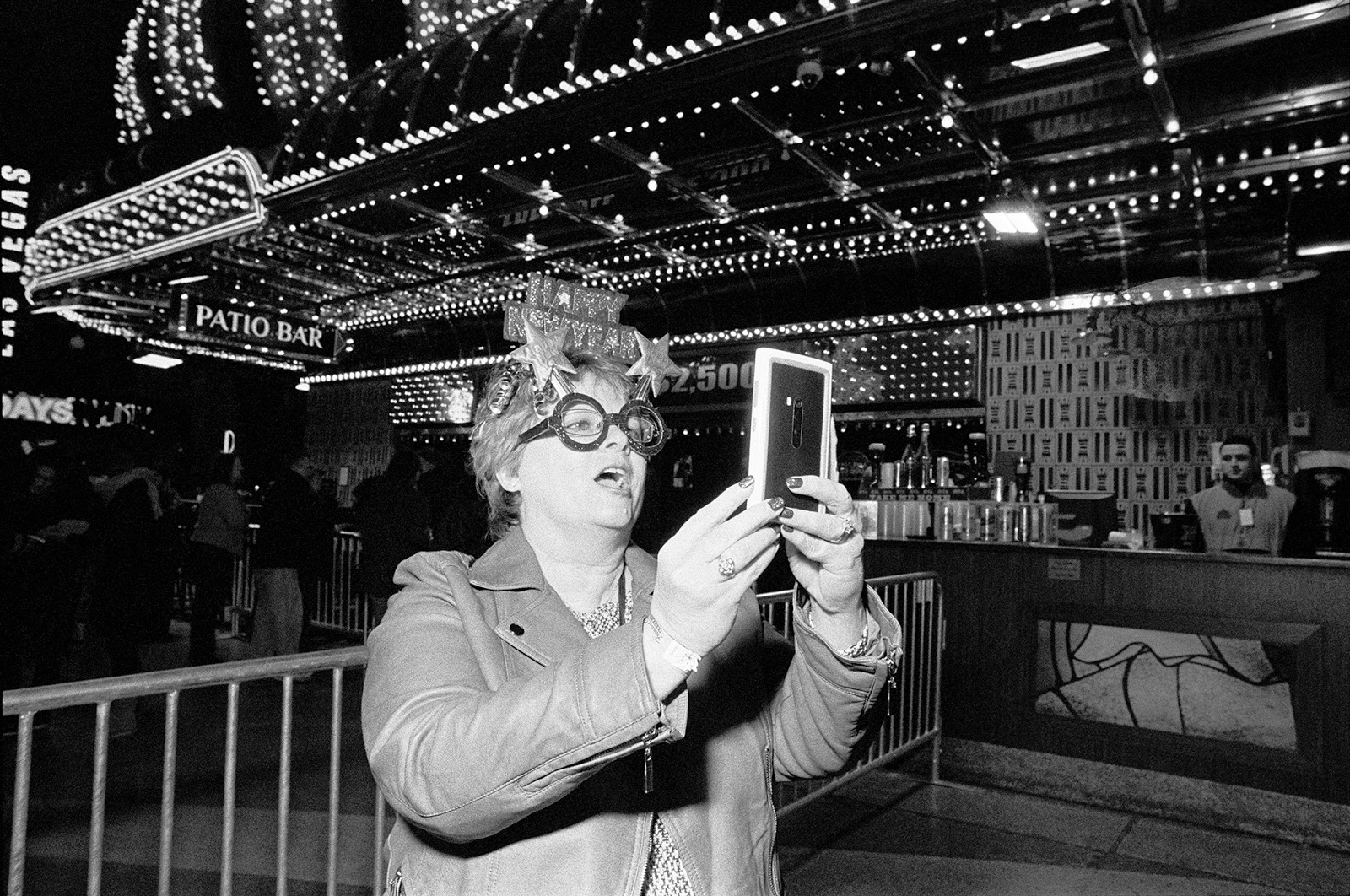 jill waterman, photographer and writer for b&H photo, takes a selfie during New Year's on the vegas strip.